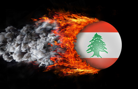 Concept of speed - Lebanon Flag with a trail of fire and smoke photo