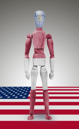 bodypaint: Old wood figure mannequin with US state flag bodypaint - Georgia Stock Photo