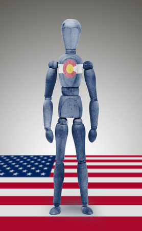 bodypaint: Old wood figure mannequin with US state flag bodypaint - Colorado Stock Photo