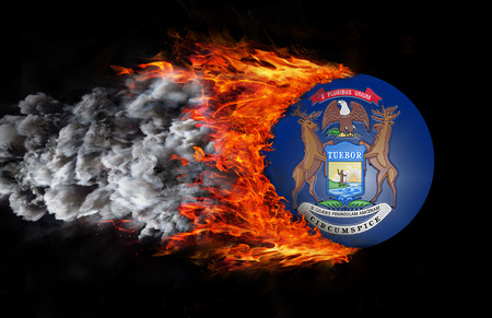 michigan flag: Concept of speed - Michigan Flag with a trail of fire and smoke