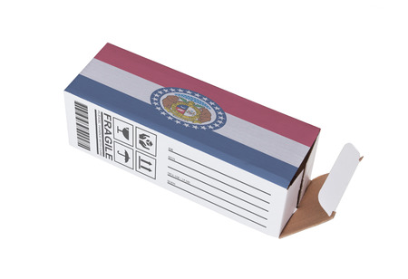 adress: Concept of export, opened paper box - Product of Missouri Stock Photo