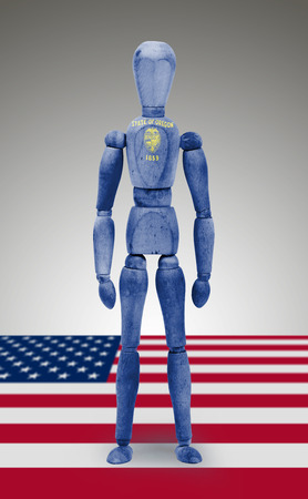 bodypaint: Old wood figure mannequin with US state flag bodypaint - Oregon Stock Photo