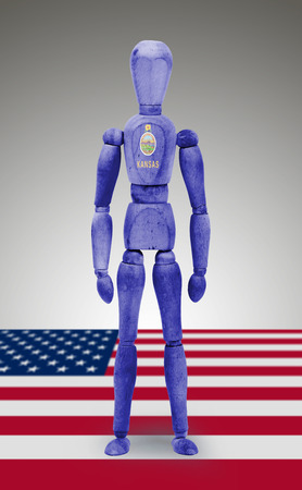 bodypaint: Old wood figure mannequin with US state flag bodypaint - Kansas Stock Photo