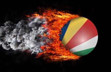 Concept van de snelheid - Vlag van Seychellen met een spoor van vuur en rook
