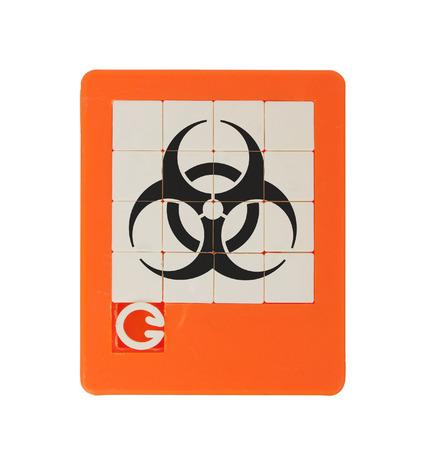 biohazard symbol: Old puzzle slide game, isolated on white - biohazard symbol Stock Photo