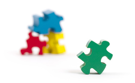 Jigsaw puzzle pieces isolated on a white background photo