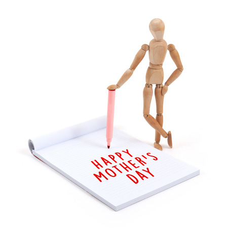 artists dummy: Wooden mannequin writing in a scrapbook - Happy mothers day