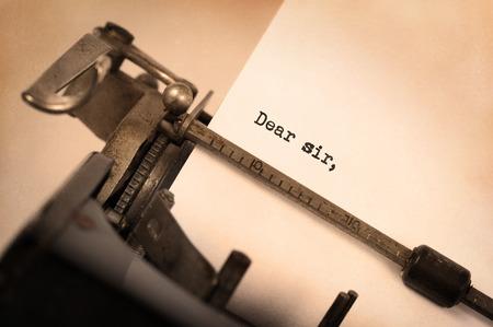 dear: Close-up of a vintage typewriter, dear sir text