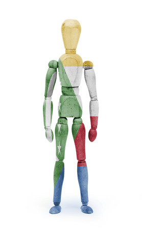 bodypaint: Wood figure mannequin with flag bodypaint on white background - Comoros