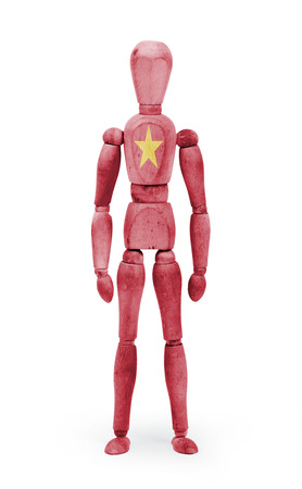 bodypaint: Wood figure mannequin with Vietnam flag bodypaint on white background Stock Photo