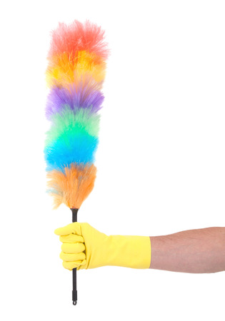 bright housekeeping: Man with yellow cleaning glove holding a duster - isolated Stock Photo