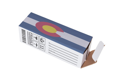 colorado flag: Concept of export, opened paper box - Product of Colorado