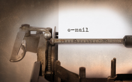 type bar: Close-up of an old typewriter with paper, e-mail typed