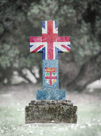 fijian: Old weathered gravestone in the cemetery - Fiji flag