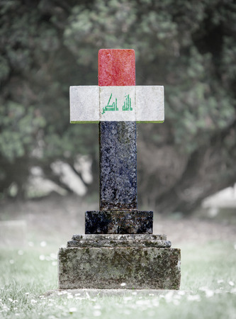 iraq flag: Old weathered gravestone in the cemetery - Iraq flag Stock Photo