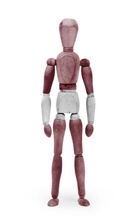 bodypaint: Wood figure mannequin with Latvia flag bodypaint on white background Stock Photo