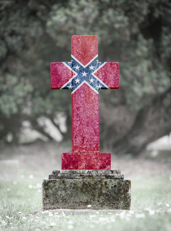 confederation: Old weathered gravestone in the cemetery - Confederation flag Stock Photo