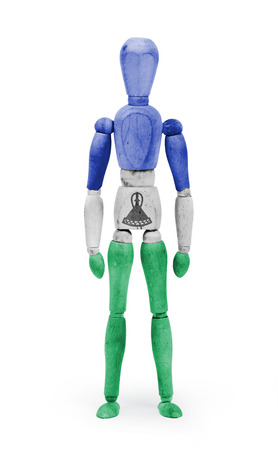 bodypaint: Wood figure mannequin with Lesotho flag bodypaint on white background Stock Photo