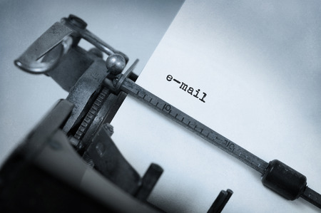 typewriter key: Close-up of an old typewriter with paper, perspective, selective focus, e-mail