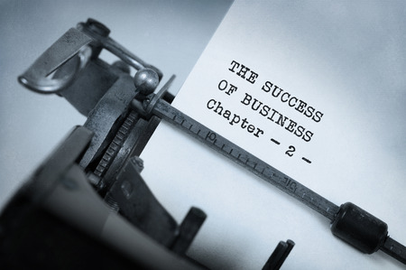 succes: Vintage typewriter, old rusty, warm yellow filter - The succes of business, chapter 2 Stock Photo