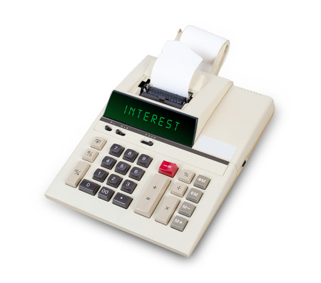 mortgaging: Old calculator showing a text on display - interest Stock Photo