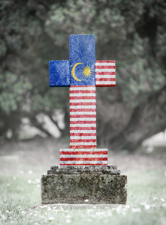 gravestone: Old weathered gravestone in the cemetery - Malaysia