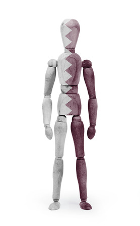 jointed: Wood figure mannequin with Qatar flag bodypaint on white background Stock Photo