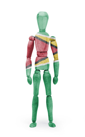 bodypaint: Wood figure mannequin with Guyana flag bodypaint on white background Stock Photo