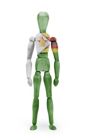 bodypaint: Wood figure mannequin with Zimbabwe flag bodypaint on white background Stock Photo