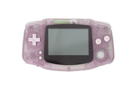 joy pad: Old dirty portable game console with a small screen, isolated on white - Pink Stock Photo