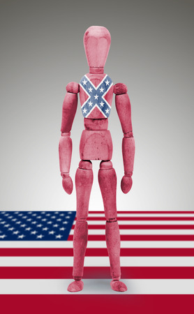 similitude: Jointed wooden mannequin isolated on white background, USA, Confederate flag Stock Photo