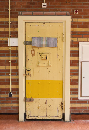 prison guard: Very old prison door, prison in the Netherlands Stock Photo