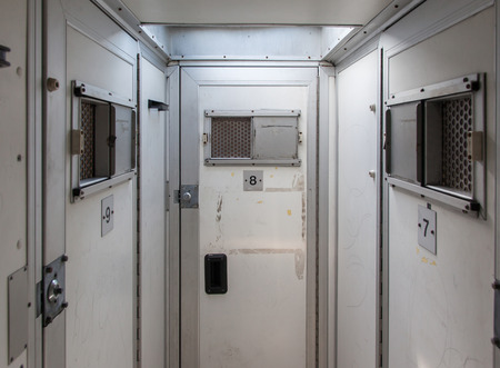 public safety: Inside of a large bus used by police to transport prisoners for public safety Stock Photo