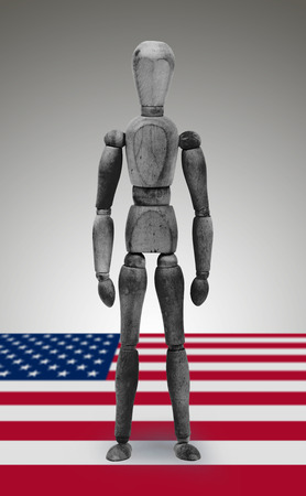 similitude: Jointed wooden mannequin isolated on white background, USA black