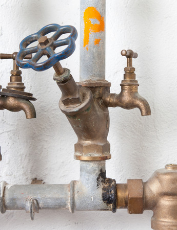 stop gate valve: Old pipelines with blue valve, plumbing in the 80s