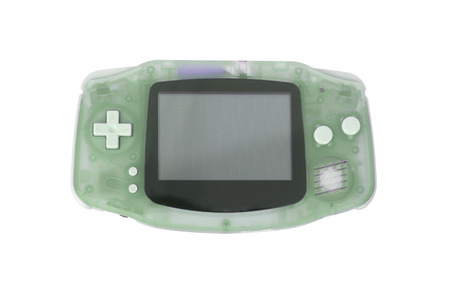 joy pad: Old dirty portable game console with a small screen, isolated on white - green