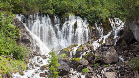 raging: Waterfall in the forest, raging water in Switzerland