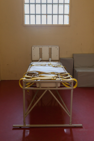 Bed for restraining psychiatric patiens, old dutch jail Stock Photo