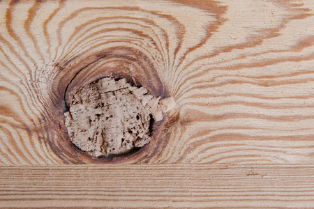80s: Knotted wooden board close up, house in Switzerland, 80s Stock Photo