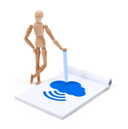artists dummy: Wooden mannequin writing in a scrapbook - Cloud Stock Photo
