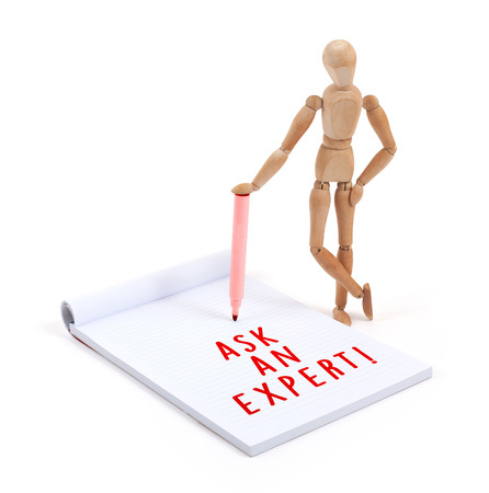artists dummy: Wooden mannequin writing in a scrapbook - Ask an expert Stock Photo