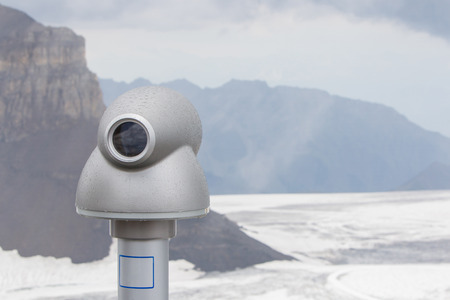 viewer: Binoculars against the grey sky, high up in the Alps, Switzerland