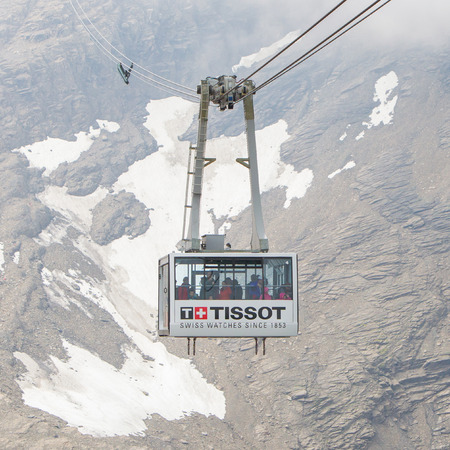 saanenland: LES DIABLERETS, SWIZTERLAND - JULY 22: Ski lift to area Glacier 3000 on July 22, 2015. The area houses the world only suspension bridge between 2 mountain peaks. Editorial