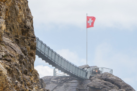 saanenland: LES DIABLERETS, SWIZTERLAND - JULY 22: People walk at the Glacier 3000 on July 22, 2015. The area houses the world only suspension bridge between 2 mountain peaks.