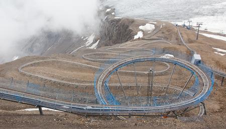 toboggan: LES DIABLERETS, SWITZERLAND - July 22, 2015 Europes highest toboggan run in the Swiss mountains on July 22, 2015.
