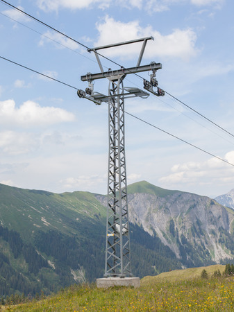 inoperative: Pole of a ski lift stands in a spring meadow Stock Photo