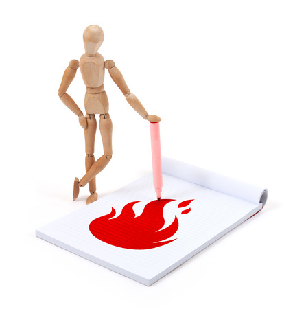 artists dummy: Wooden mannequin writing in a scrapbook - Fire