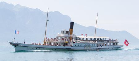excursion: Swiss excursion boat sailing on Lake Geneva Editorial