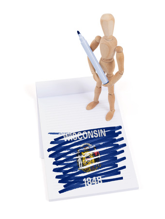 jointed: Wooden mannequin made a drawing of a flag - Wisconsin Stock Photo