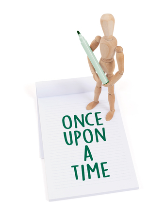 artists dummy: Wooden mannequin writing in a scrapbook - Once upon a time